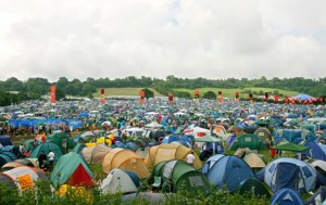 Thousands of tents are pitched by music