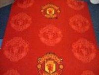 Onder meer het tapijt van Manchester United is gemaakt met garen uit Peer.
