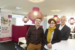 Stijn Germeys en Eric Martens van Flexpoint flankeren Ingrid Jaspers.